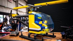 A giant flying Lego helicopter drone made out of foam